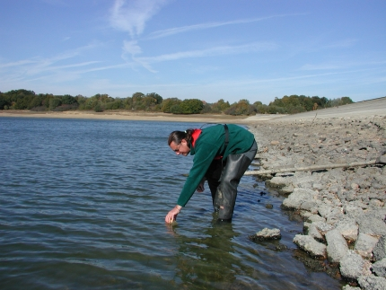 Tim Smith collecting a water sample at Darwell Reservoir, Battle, East Sussex