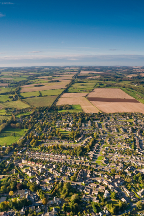 Aerial photograph of housing and surrounding farmland in the Cotswolds